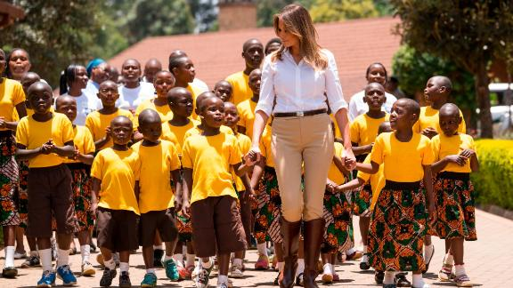 First lady Melania Trump walks with children from the Nest Orphanage during her visit to Nairobi.