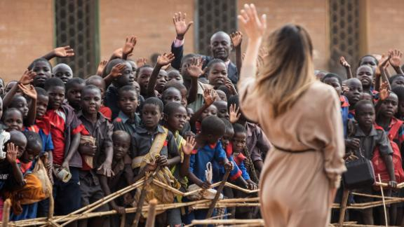 First lady Melania Trump waves to children at Chipala Primary School.