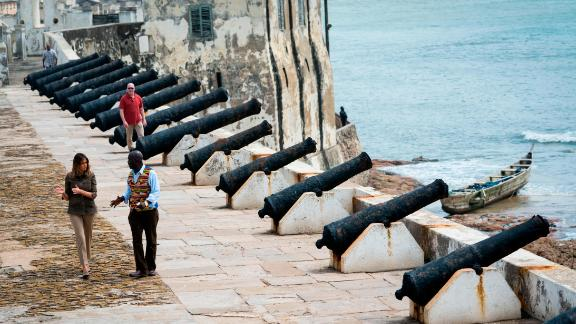 Museum educator Kwesi Essel-Blankson and first lady Melania Trump tour the Cape Coast Castle, one of dozens of hubs in the trans-Atlantic slave trade.