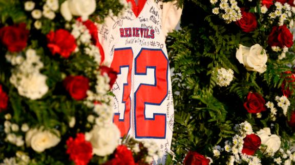 Dylan Thomas' No. 32 jersey hangs in a wreath of roses before the Pike County High School game against Rutland High School on Friday.