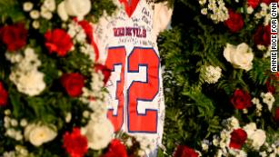 Dylan Thomas' jersey hangs in a wreath of roses before the Pike County High School game against Rutland High School.