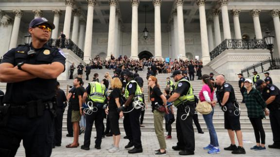 Capitol Police arrest protesters Saturday after they occupied the center steps of the east front of the US Capitol.