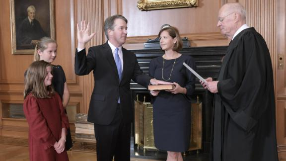 Justice Anthony M. Kennedy, (Retired) administers the Judicial Oath to Judge Brett M. Kavanaugh in the Justices' Conference Room, Supreme Court Building. Mrs. Ashley Kavanaugh holds the Bible.Credit: Fred Schilling, Collection of the Supreme Court of the United States