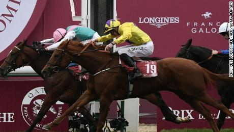 Enable, ridden by Frankie Dettori, just holds off James Doyle on Sea Of Class to win the  2018 Qatar Prix de l'Arc de Triomphe flat race at the ParisLongchamp.