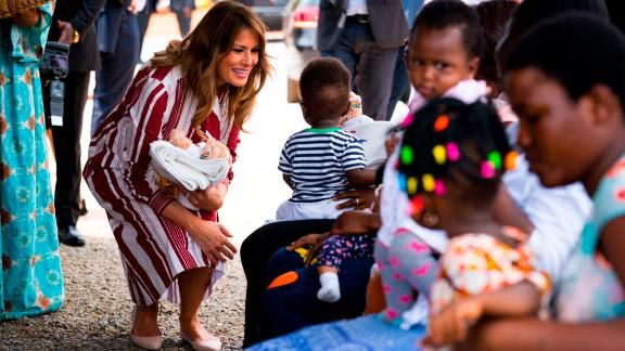 """First lady Melania Trump hands out teddy bears and """"Be Best""""-themed blankets donated by the White House to young children and their mothers at the Greater Accra Regional Hospital in Accra, Ghana."""