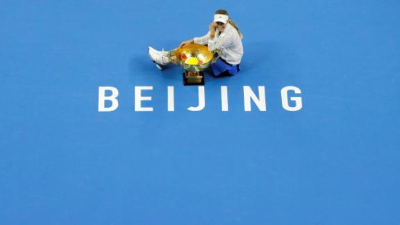 Caroline Wozniacki of Denmark poses with her trophy after defeating Anastasija Sevastova of Latvia during the women's singles finals at the China Open on October 7, 2018.