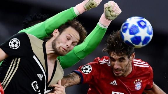 Javi Martinez of Bayern Munich, and Daley Blind and goalkeeper Andre Onana of Ajax Amsterdam fight for the ball in the air during a Champions League match on October 2, 2018.