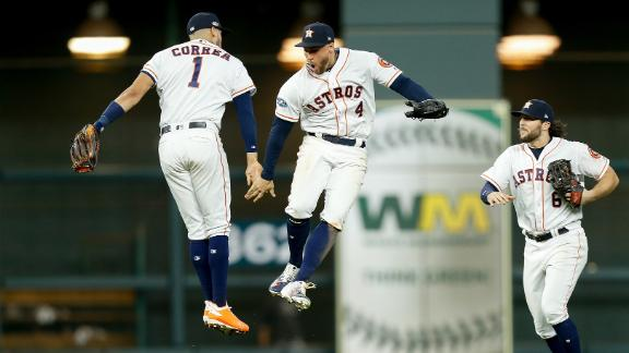 Carlos Correa, George Springer and Jake Marisnick of the Houston Astros celebrate after defeating the Cleveland Indians 3-1 in Game Two of the American League Division Series at Minute Maid Park in Houston, Texas.