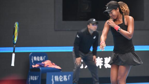 Naomi Osaka of Japan throws her racquet during her women's quarter-final match against Zhang Shuai of China at the China Open tennis tournament in Beijing on October 5, 2018. Osaka advanced to the semi-finals where she was defeated in two sets by Anastasija Sevastova.