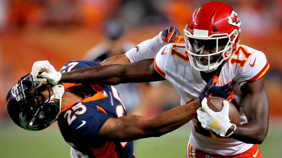 Kansas City Chiefs wide receiver Chris Conley stiff arms Denver Broncos defensive back Chris Harris during the second half of their game on Monday, October 1, 2018, in Denver, Colorado.