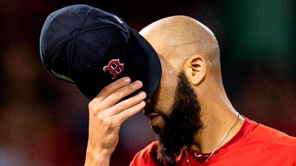 David Price of the Boston Red Sox covers his face with his cap as he exits the game during the second inning of game two of the American League Division Series against the New York Yankees on October 6, 2018 at Fenway Park in Boston, Massachusetts. Price was credited with the loss as the Yankees went on to win the game and tie the series 1-1.