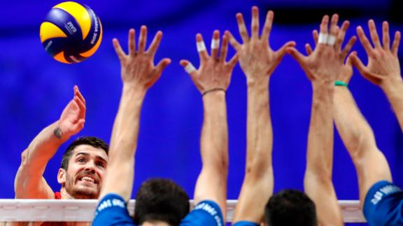United States' Matthew Anderson, left, spikes as Serbia's Nemanja Petric, Marko Podrascanin, and Drazen Luburic jump to block the ball during the 2018 FIVB Men's World Championship's third place match between USA and Serbia, in Turin, Italy, Sunday, Sept. 30, 2018.