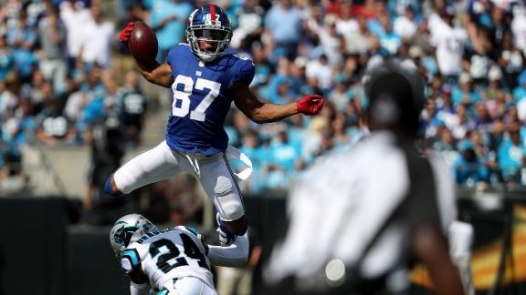 Sterling Shepard of the New York Giants jumps over James Bradberry of the Carolina Panthers in the second quarter during their game at Bank of America Stadium on October 7, 2018 in Charlotte, North Carolina.