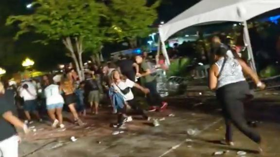 Rap fans flee a Lil Wayne concert in Atlanta.