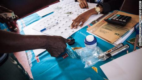 """We heard gunshots all through the day,"" says Cameroon voter"