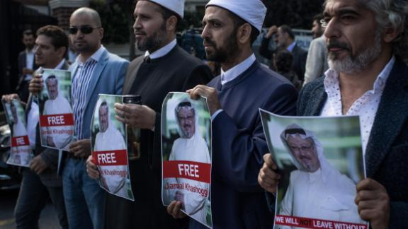 People hold posters of Saudi journalist Jamal Khashoggi during a protest organized by members of the Turkish-Arabic Media Association at the entrance to the Saudi Arabia Consulate on October 5, 2018 in Istanbul.