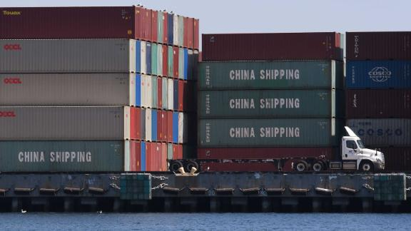 """This photo shows Chinese shipping containers that were unloaded at the Port of Long Beach, in Los Angeles County, on September 29, 2018. - President Donald Trump insisted that there had been """"absolutely no impact"""" on the US economy from the escalating trade dispute between his administration and China. """"We have to make it fair. So we're at $250 billion now, 25 percent interest,"""" he said in reference to a package of tariffs imposed on Chinese imports. (Photo by Mark RALSTON / AFP)        (Photo credit should read MARK RALSTON/AFP/Getty Images)"""