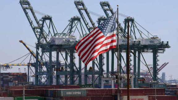 Shipping containers from China are unloaded at the Port of Long Beach. The US trade deficit edged up in March as American companies imported more than they exported, figures show.