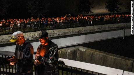 AMSTERDAM, NY - OCTOBER 08: Mourners attend a candlelight vigil for the victims of the fatal limousine crash on October 8, 2018 in Amsterdam, New York. 20 people died in the crash including the driver of the limo, 17 passengers, and two pedestrians. (Photo by Stephanie Keith/Getty Images)