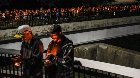 Mourners attend a Monday night candlelight vigil for victims of the fatal limousine crash.