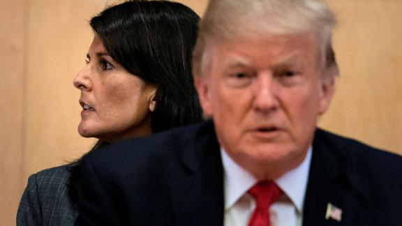 US Ambassador to the UN Nikki Haley and US President Donald Trump wait for a a meeting on United Nations Reform at UN headquarters in New York on September 18, 2017. / AFP PHOTO / Brendan Smialowski        (Photo credit should read BRENDAN SMIALOWSKI/AFP/Getty Images)