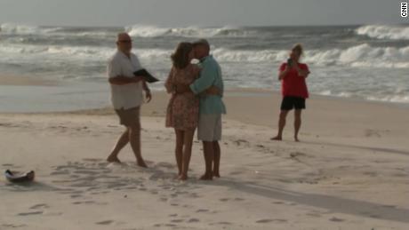 Cindy and Benny Guinn kiss at their wedding Tuesday morning in Panama City Beach, Florida.