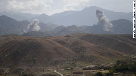 "In this photo taken on July 7, 2018, smoke rises after an air strike bomb on Islamic State (IS) militants positions in a checkpoint at the Deh Bala district in the eastern province of Nangarhar Province. - A US soldier was killed and two others wounded in an ""apparent insider attack"" in southern Afghanistan on July 8, NATO said, the first such killing in nearly a year. (Photo by WAKIL KOHSAR / AFP)        (Photo credit should read WAKIL KOHSAR/AFP/Getty Images)"