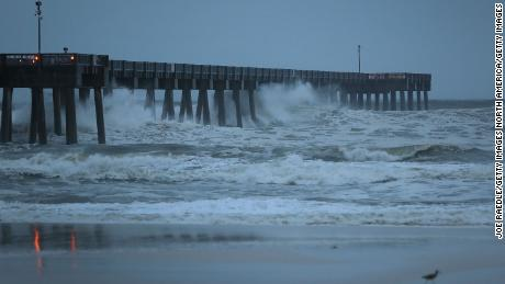 Waves crash along a pier in Panama City Beach, Florida, just hours before the expected landfall.