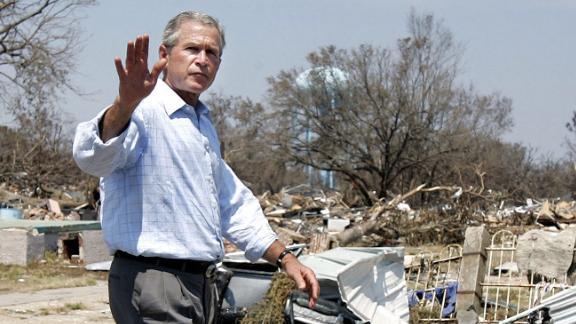 President Bush waves as he takes a walking tour of Biloxi, Mississippi, after Hurricane Katrina on September 2, 2005.