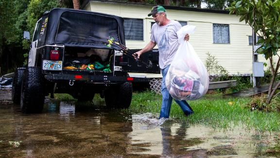 Mitchell Pope tries to salvage what he can from his mobile home in St. Marks.
