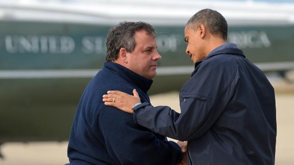President Barack Obama is greeted by New Jersey Governor Chris Christie upon arriving in Atlantic City, New Jersey, on Oct. 31, 2012, to visit areas hardest hit by Sandy.