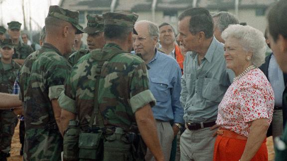 President George H. W. Bush, Barbara Bush and Secretary of Defense Richard Cheney visit with Marines taking part in the disaster relief efforts in the aftermath of Hurricane Andrew in Homestead, Florida on Sept. 1, 1992.