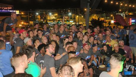 Gay Bowl XVIII athletes congregated at a welcoming party at a rooftop bar in Denver, Colorado.