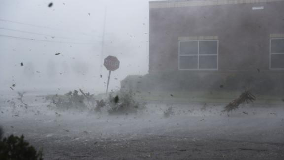 PANAMA CITY, FL - OCTOBER 10:  Debris is blown down a street by Hurricane Michael on October 10, 2018 in Panama City, Florida. The hurricane made landfall on the Florida Panhandle as a category 4 storm.  (Photo by Joe Raedle/Getty Images)