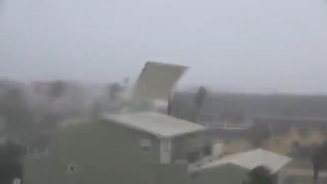 Hurricane wind tears roof off home