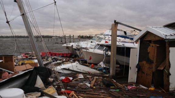 Wrecked boats sit near a pier in Panama City.