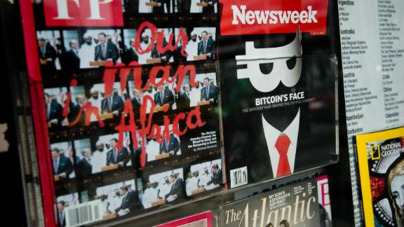 A copy of the new print edition of Newsweek magazine is displayed in the window of a newsstand in Washington on March 10, 2014.