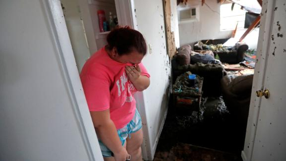 Kaylee O'Brian cries inside her Panama City home after several trees fell on it on October 10.