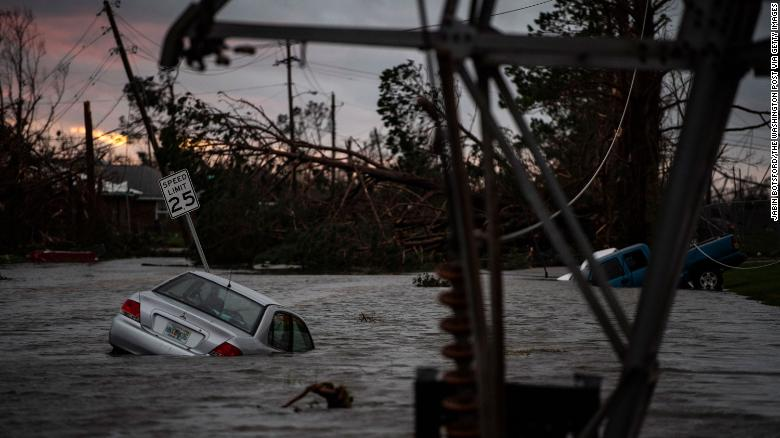 PANAMA CITY BEACH, FL - OCTOBER 10 : A car is seen caught in flood water after category 4 Hurricane Michael made land fall along the Florida panhandle, on Wednesday, Oct. 10, 2018 in Panama City, FL. (Photo by Jabin Botsford/The Washington Post via Getty Images)