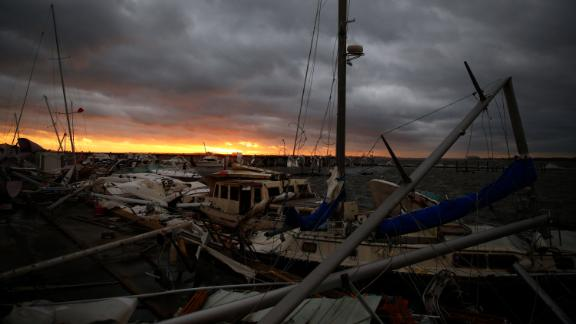 Boats are left damaged in a Panama City marina on October 10.