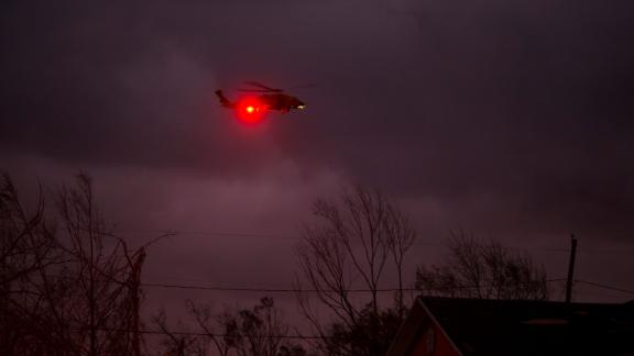 A helicopter circles a Panama City neighborhood in the storm's wake on October 10.
