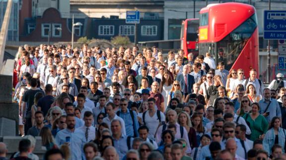 Crowds of commuters walk to work across London Bridge in London, England on August 03, 2018 during hot sunny weather as the heatwave continues in the capital and across Europe.  (photo by Vickie Flores/In Pictures via Getty Images)