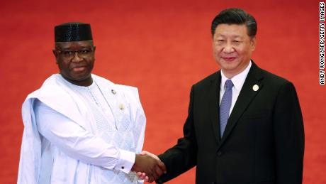 Sierra Leone's President Julius Maada Bio (L) shakes hands with China's President Xi Jinping during the Forum on China-Africa Cooperation at the Great Hall of the People in Beijing on September 3, 2018.