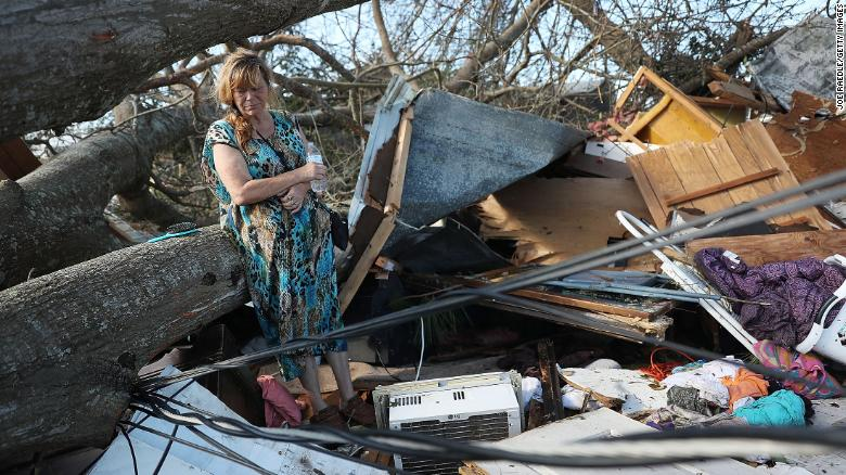 Kathy Coy looks at the remains of her Panama City home Thursday after Hurricane Michael destroyed it.