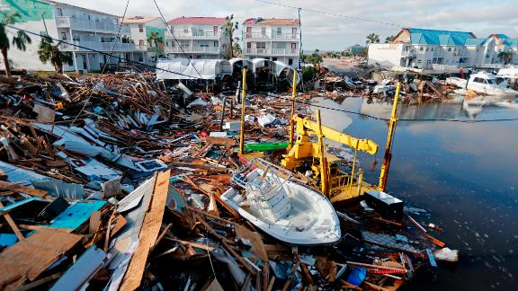 A boat sits amid debris in Mexico Beach on October 11.