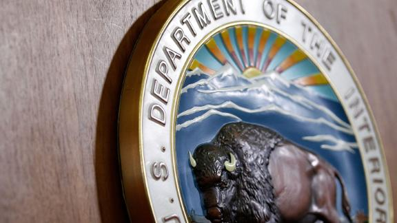 The seal of U.S. Interior Department is seen during a news conference May 11, 2010 in Washington, DC.  Secretary of Interior Ken Salazar announced that he would split the Minerals Management Service into two agencies, one would in charge the inspection of oil rigs, investigation of oil companies, and enforcement of safety regulations, as the other would supervise drilling leases and royalty dollar collections.  (Alex Wong/Getty Images)