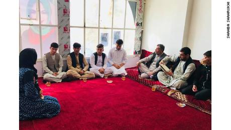 Shahba Shahrukhi speaks to a group of men in her campaign headquarters in Samangan Province.
