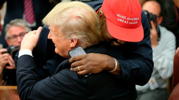 WASHINGTON, DC - OCTOBER 11:  (AFP OUT) (EDITORS NOTE: Retransmission with alternate crop.) U.S. President Donald Trump hugs rapper Kanye West during a meeting in the Oval office of the White House on October 11, 2018 in Washington, DC. (Photo by Oliver Contreras - Pool/Getty Images)