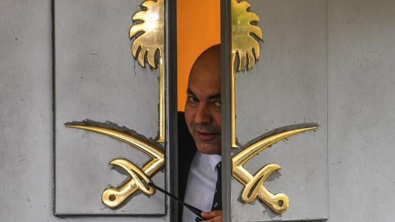 A security officer peers through a partially open door at the Saudi consulate in Istanbul on Friday.