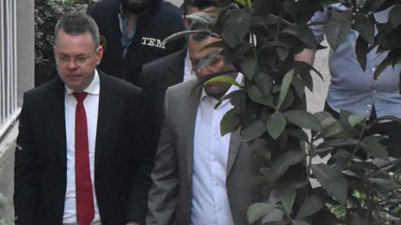 Andrew Brunson arrives back at his home in Izmir, Turkey, after his trial on Friday.